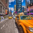 NEW YORK - MAY 14: Yellow cabs speed up in the city, May 14, 201 — Stock Photo