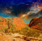 Beautiful rocks of Australian Outback against colourful sky — Stock Photo