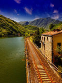 Railway with River, Sky and Vegetation in Tuscany — Stok fotoğraf