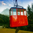 Stock Photo: Red Cable Car on a mountain landscape