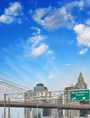 Interstate exit sign with Manhattan skyline on background — Stock Photo