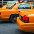 NEW YORK - JUN 11: Yellow cab speeds through Times Square — Stock Photo