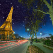 Beautiful car light trails in front of Eiffel Tower — Stock Photo