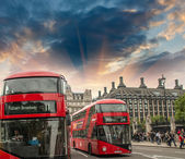 Classic red double decker bus in city streets — Stock Photo