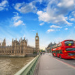 Double Decker red bus crossing Westminster Bridge. — Stock Photo