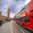 Iconic Red Double Decker Bus speeding up in Westminster Bridge — Photo