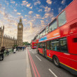 Stock Photo: Iconic red bus passing over Westminster Bridge in London