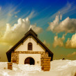 Small Church on a snowy Mountain Peak. — Stock Photo