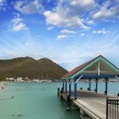 Stock Photo: Wharf over pristine caribbebeach at sunset