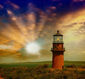 Lighthouse on a beautiful island. Sunset view with trees and sea — Stock Photo