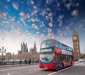 London. Classic red double decker bus crossing Westminster Bridg — Foto de Stock