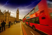 Storm in London with Red Bus crossing Westminster Bridge — Stock Photo