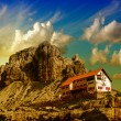 Stock Photo: Shelter under a Giant Muntain. Three Peaks of Lavaredo, Italy