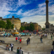 LONDON, SEP 29: Tourists enjoy beautiful Trafalgar Square, Septe — Stock Photo