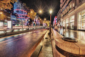 Car light trails in famous Champs Elysees — Stock Photo