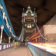 Detail of Tower Bridge in London at night with car light trail - — Stock Photo #34634381