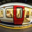 Train arriving at subway station in London, UK — Stock Photo