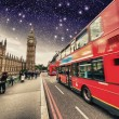 Iconic Red Double Decker Bus speeding up in Westminster Bridge a — Stock Photo