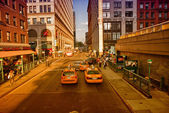 NEW YORK - MAY 14: Yellow cabs speed up in the city, May 14, 201 — ストック写真