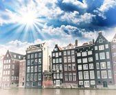Amsterdam. Beautiful view of classic buildings with colourful sk — Stock Photo