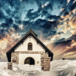 Small Church on a snowy Mountain Peak. Beautiful winter sunset c — Stock Photo