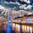 London at night. Thames river with The Eye Panoramic Wheel — Stock Photo #35086597