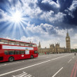 Red Double Decker Bus speeding up to Big Ben Tower on Westminste — Stock Photo