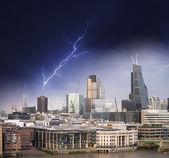 Night over modern city skyline — Stock Photo