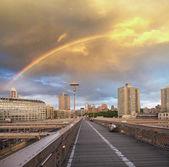 Rainbow and dramatic sky over New York skyline — Stock Photo