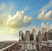 Lower Manhattan skyline as seen from Brooklyn Bridge at sunset — Stock Photo