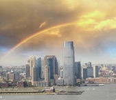 Jersey City skyline with Hudson river, aerial view with rainbow — Stock Photo