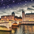 Stock Photo: Beautiful colors of Napoleon Bridge at night with Seine river -