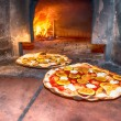 Pizzas baked in wood oven — Stock Photo
