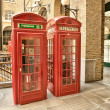 Red Phone Booth on streets of London — Stock Photo #35760567