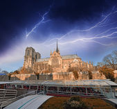 Paris. Notre Dame during a storm with cruise boat — Stock Photo