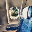 Airplane blue seat with a view — Stock Photo