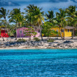 Caribbean Beach with quintessential colorful homes — Stock Photo