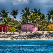 Beautiful colorful homes on a caribbean beach — Stock Photo