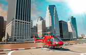 Modern red helicopter ready to take off in New York summer skyline — Stock Photo