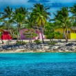 Caribbean Beach with quintessential colorful homes — Stock Photo #36797731