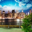 Manhattan skyline at night as seen from Brooklyn Bridge — Stock Photo