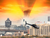 Black Helicopter hovering over New York buildings — Stock Photo