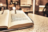 Open book on the kitchen table — Stock Photo