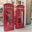 Red Phone Booth on streets of London — Stock Photo #37280687