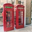 Red Phone Booth on the streets of London — Stock Photo #37280687