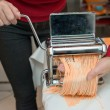 Woman Chef making simple homemade noodles with pasta machine. — Stock Photo