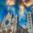 Stock Photo: Siencathedral against bright sunset sky in Tuscany, Italy