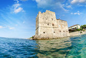 Ancient tower over the ocean, view from the water — Stock Photo