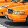 Stock Photo: Taxis in New York. Yellow cabs in pole position at traffic light