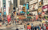 NEW YORK - MAY 22: Tourists walk in busy Times Square intersecti — Stock Photo